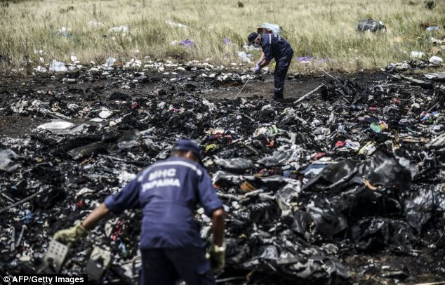 Recovery: Identifiable bodies have been placed in refrigerated trains but belongings remain strewn about
