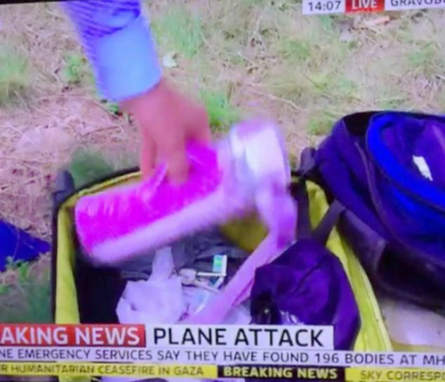 Apology: Sky News reporter Colin Brazier apologised after rifling through a case at the scene of the crash