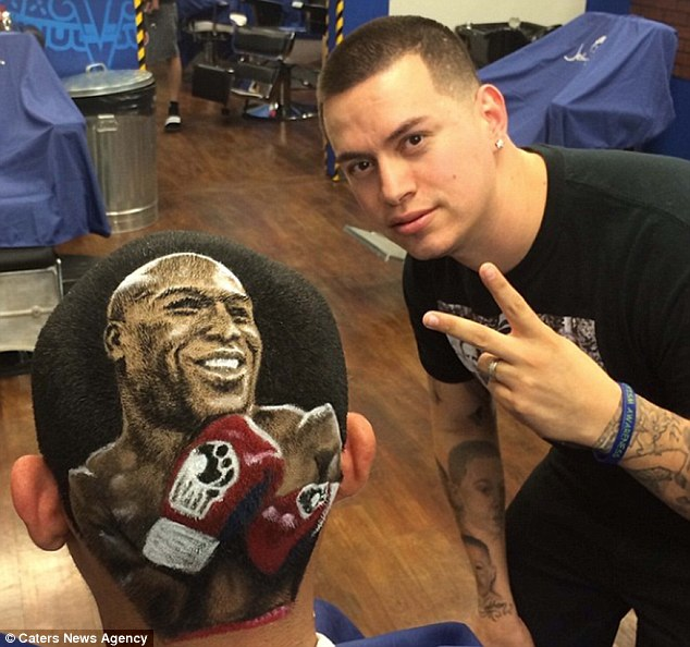 Hard-hitting look: This boxing aficionado has had Floyd Mayweather crafted into the back of his head by Mr Ferrell (right)