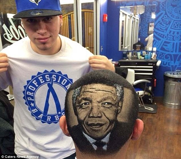 Iconic: Mr Ferrell stands proudly next to his Nelson Mandela design