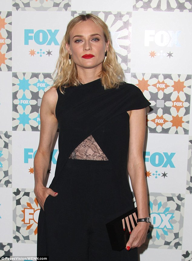 Asymmetric: The Bridge star finished off her bizarre look with severe red lipstick and a matching manicure to go with her whimsical clutch