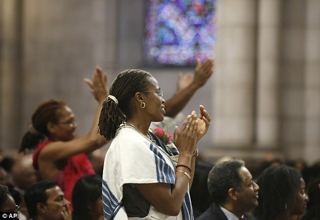 Audience: Members of the congregation at Riverside Church applaud during a guest appearance by The Rev. Al Sharpton