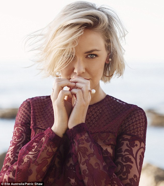 Not married: Lara Bingle has denied she and Sam Worthington have married despite the fact the pair wear matching bands on their ring fingers and the actor often refers to her as his 'wife'