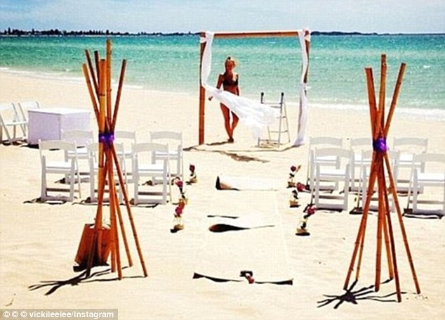 Secret wedding? The couple first sparked speculation they had wed when Lara's best friend posted a photo of the model standing beside an altar with the caption: 'Here comes the bride, all dressed in bikini'