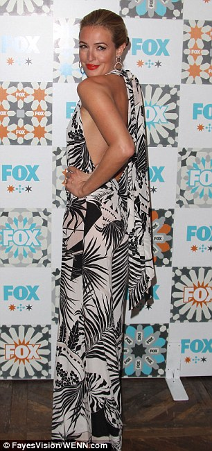 Ready for a resort! So You Think You Can Dance host Cat Deeley showcased her tanned and toned back in a tropical-print plunging halter gown