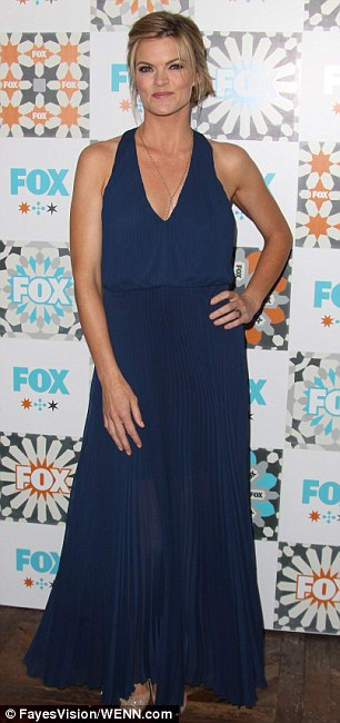 Back flasher: Blonde funnywoman Missi Pyle - who has appeared on The Mindy Project - looked fierce at 41 in her navy blue pleated maxi-dress
