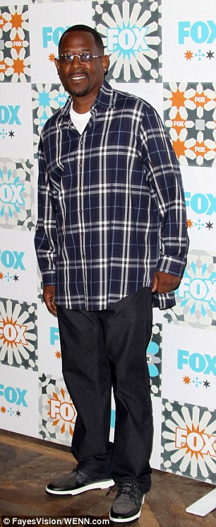 Twinsies! Sons of Anarchy stud Charlie Hunnam and Partners funnyman Martin Lawrence both wore eerily similar tartan tops to the party