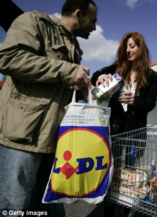 Shoppers leave a supermarket of German discount grocery chain Lidl in Berlin, Germany.