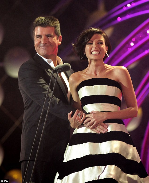 Flirty: Simon Cowell's affections for Ms Minogue were revealed in an unauthorised book last summer, and details of an affair began to come to light