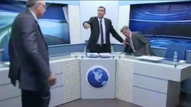 Fury: The programme, on satellite channel JoSat, pitted Shaker al-Johari (far left) against Samih Khrais (right), on the subject of the Syrian civil war on Friday night