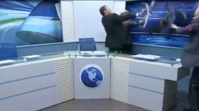 Chair attack: Al-Johari, well-known in his homeland for his strong anti-Assad views, hurled a bottle of water at Mr Khrais and then his pen. When Khrais tried clumsily to lift his chair, the bigger al-Johari went for him, wresting the seat from his grasp before attempting to beat him with it