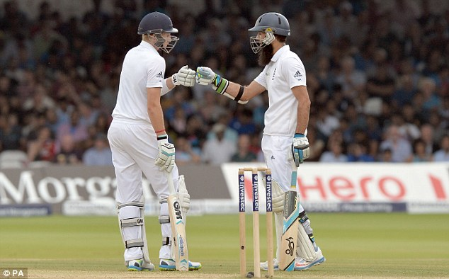 Going well: Root and Ali touch gloves as their partnership reaches 100