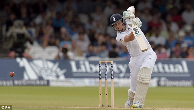 On the front foot: Root drives the ball to the boundary during a positive morning session for England