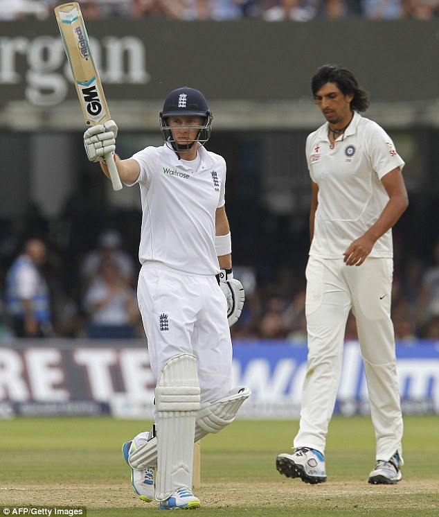 Halfway there: Root salutes his 50 on a good morning for England