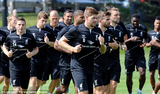 Captain: Gerrard leads the way for Liverpool during training at Harvard University on Monday