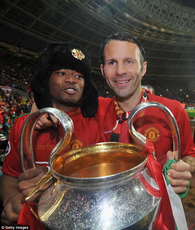 Euphoria: Evra celebrates Champions League success in 2008 with Ryan Giggs