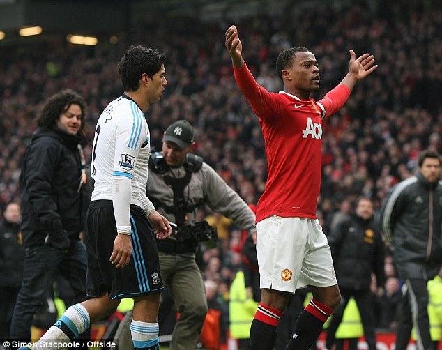Passion: Evra celebrates infront of Suarez following United's win over arch-rivals Liverpool at Old Trafford
