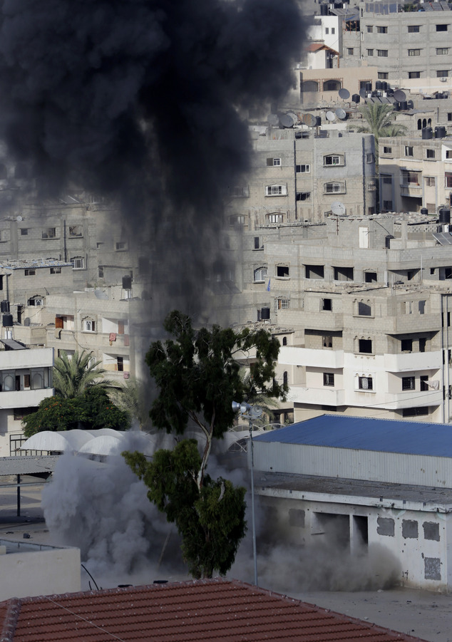 Smoke rises after an Israeli missile strike in Gaza City, in the northern Gaza Strip, on Sunday