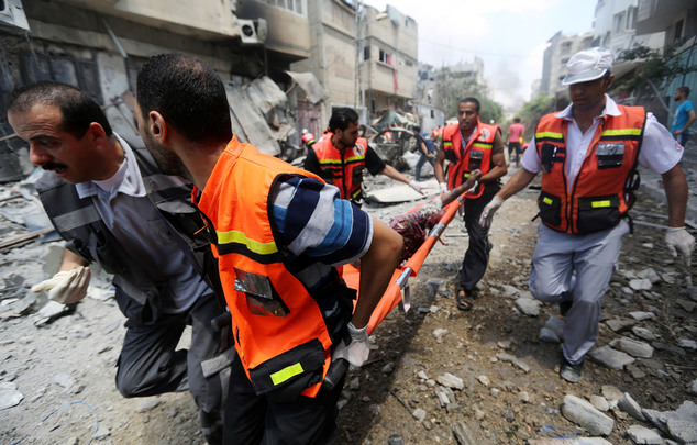 Palestinian medics carry a man injured in Gaza City's Shijaiyah neighborhood that came under fire: Some 380 Palestinians and seven Israelis have been killed in the nearly two-week conflict