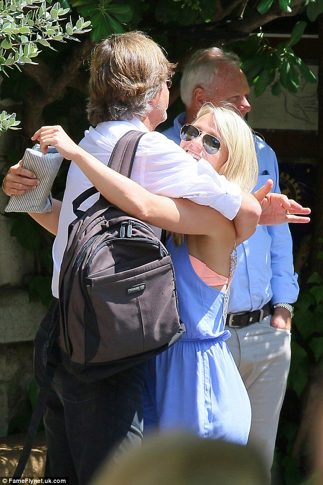 Daddy's girl: Richard Madeley gives his daughter Chloe a big hug as she joins him and his wife Judy Finnigan on holiday