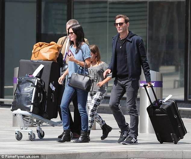 Loved-up: Courteney and Johnny became engaged not long after she turned the big 5-0 on June 15