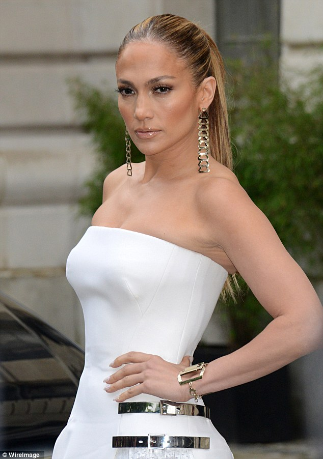 White hot: The I'm Real singer stole the show in a clingy white dress as she attended the Versace show during the Paris Fashion Week in July 2014