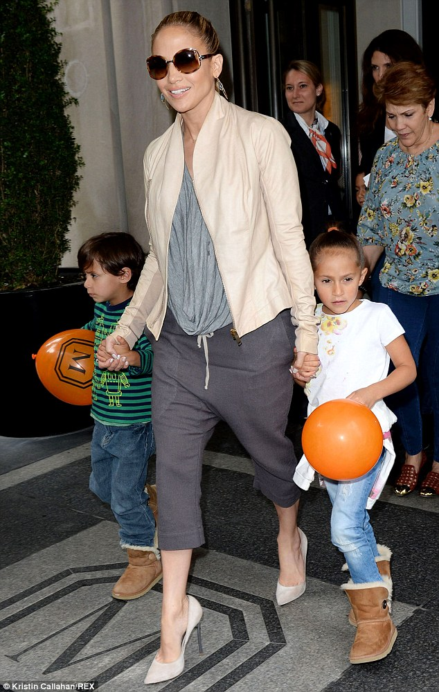 A family affair: The Waiting For Tonight singer held the hands of her children Max and Emme, while her mother Guadalupe followed close behind in New York City in May 2014
