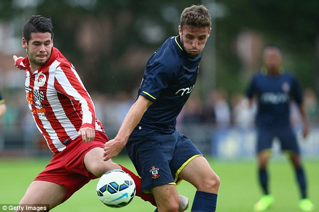 Tied down: Sam McQueen (right) has recently penned a new four-year deal at Southampton