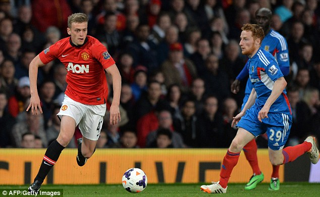 Dream start: James Wilson (left) scored twice in his Manchester United debut against Hull last season