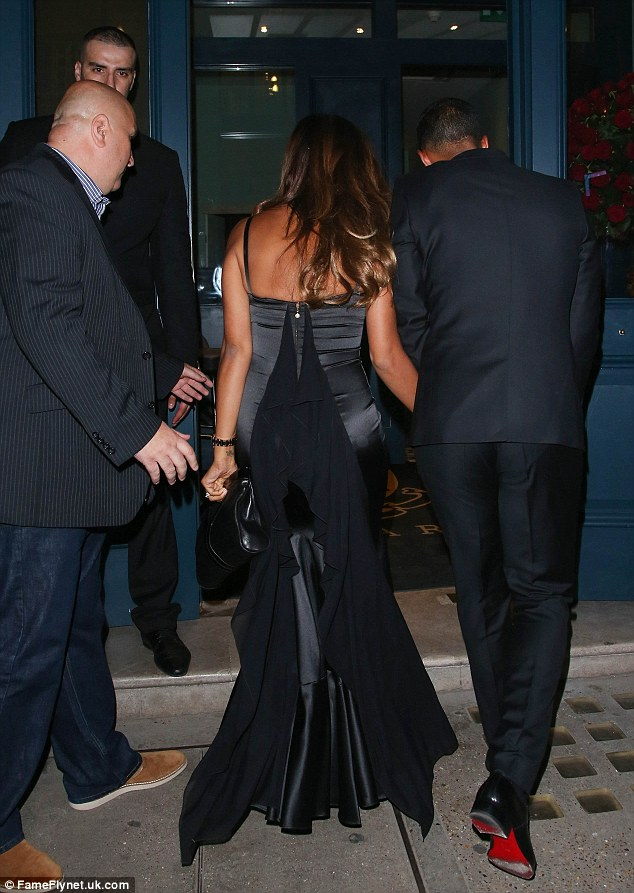 Fab from the back: Rochelle showed off her fabulous curves in a figure-fitting fishtail gown that cascaded into a long train at the back