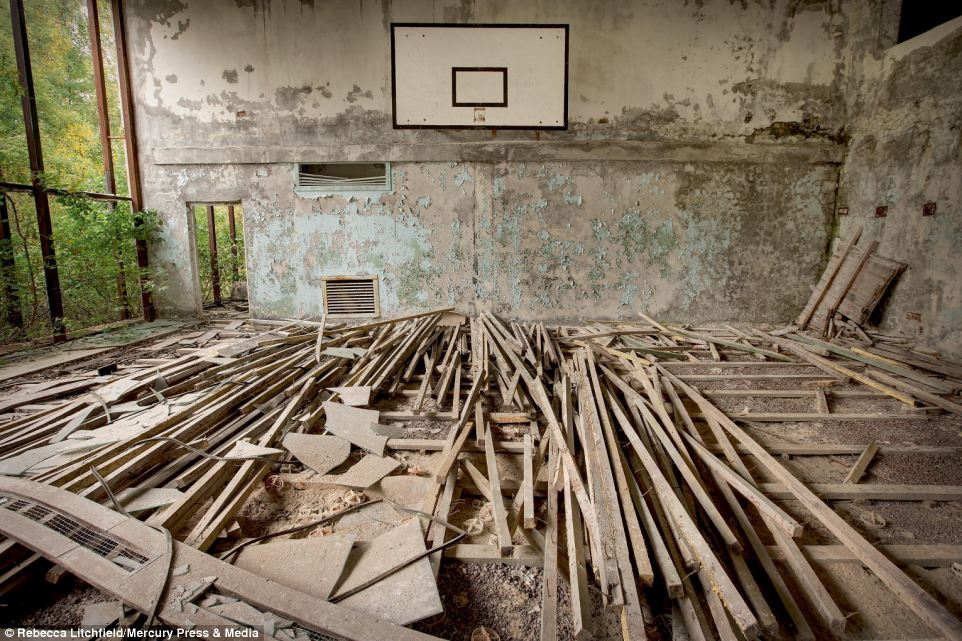 An abandoned hall at Chernobyl Sports Centre, in Ukraine, has been left, exposed to the elements, after the 1986 disaster