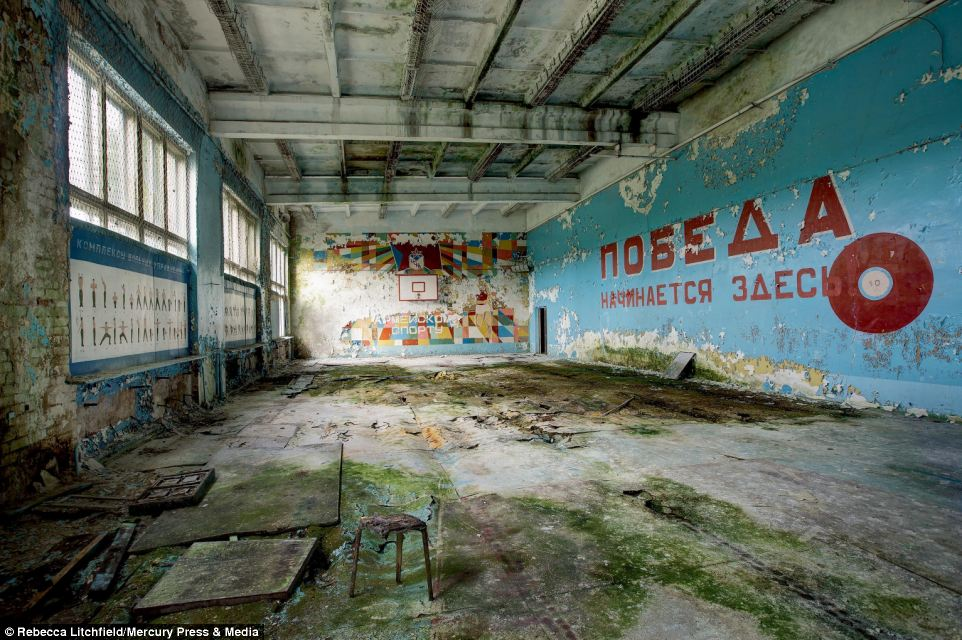 Ms Litchfield said: 'Some places would have been thriving and others horrible places to be and you can see this reflected in my book and some of the accompanying text.' Pictured is an abandoned sports hall in Latvia