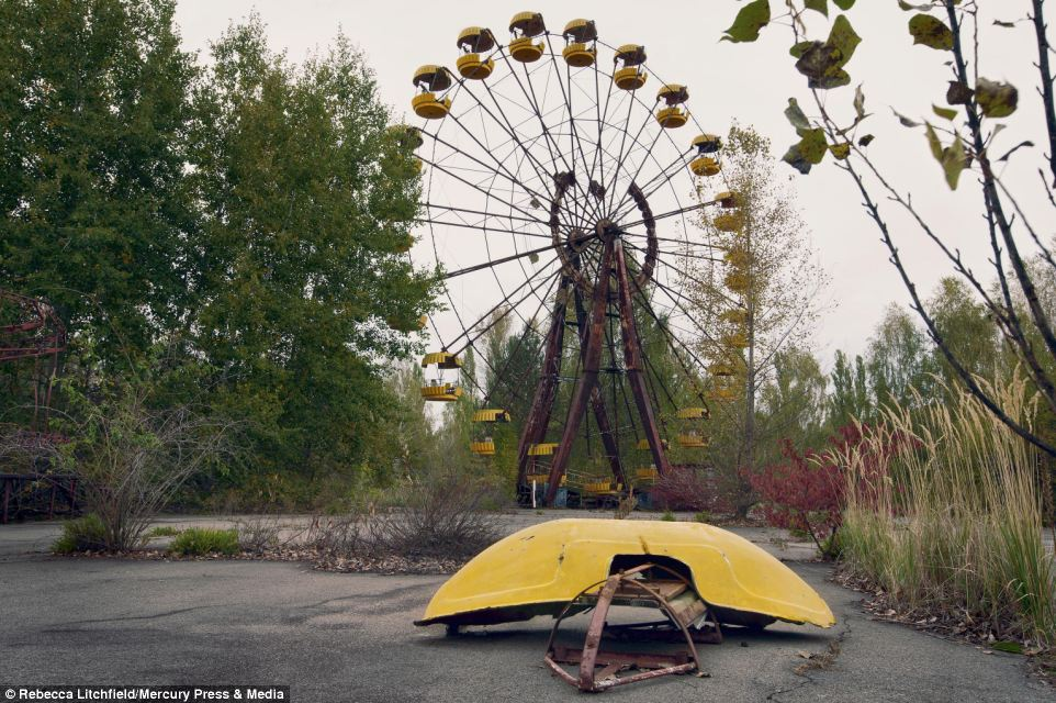 Ms Litchfield said: 'Some people may see the ruins of this time as destructive but I see the beauty in the decay like a memory hanging on that will soon be lost in a breeze.' Pictured is the Pripyat fairground which never officially opened because of the 1986 Chernobyl disaster
