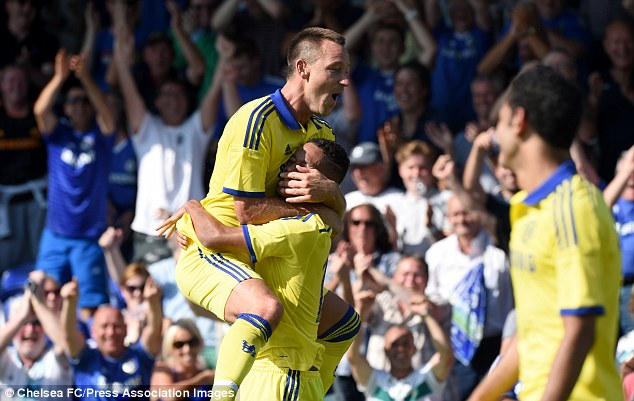 Captain, leader, legend: John Terry has already got his pre-season off to a flyer, celebrating against Wimbledon