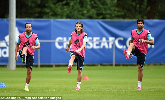 Best foot forward: Chelsea's new players - Fabregas, Felipe Luis and Costa - in training