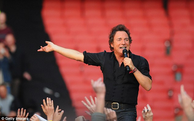 Fans favourite: Springsteen climbs above the crowd on his appearance at Arsenal's ground