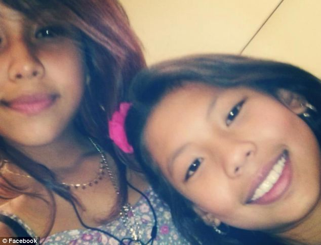 Missed: Martha (right), pictured with a friend, was a popular A-grade student, her parents said