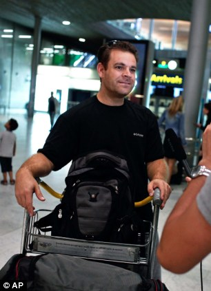 A passenger from the diverted Delta Air Lines flight 468 from New York to Tel Aviv, Daniel Leon, 39, from Tel Aviv, is filmed by an Associated Press journalist, in Roissy Charles de Gaulle airport