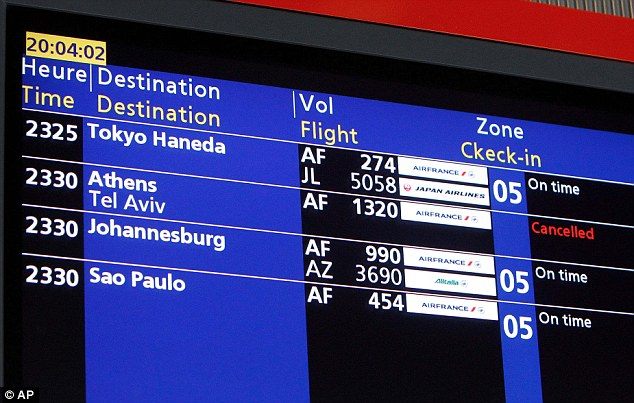 A departure board at Charles de Gaulle airport in Paris shows the cancelled Air France Flight 1320 to Tel Aviv