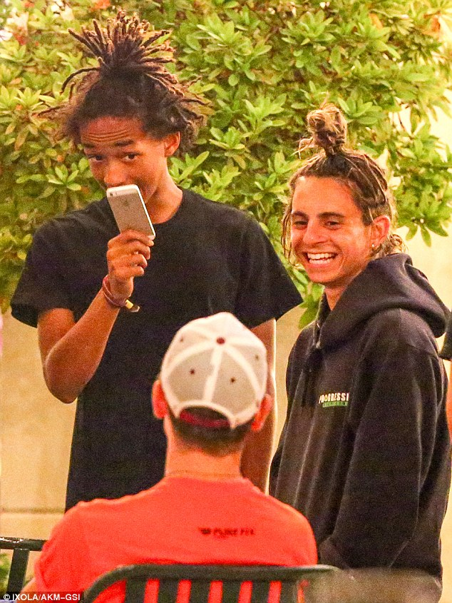 Meanwhile: Down the street, Jaden Smith, 16, and his buddy Moises Arias, 20, sported matching spiky dreadlock hairstyles as they larked around together