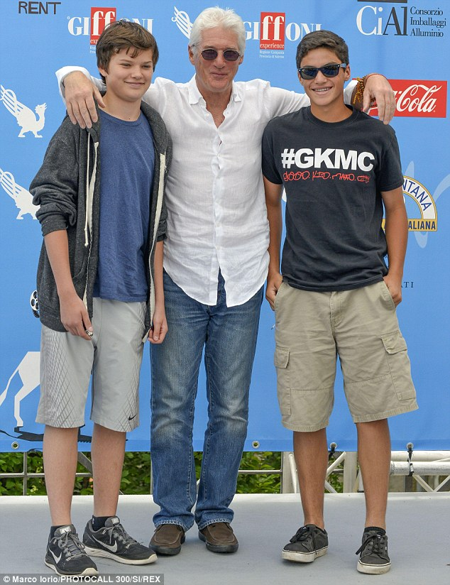 Say cheese: Richard Gere is joined by son Homes James Jigme (L) and a nephew at the 44th annual Giffoni Film Festival in Italy on Tuesday