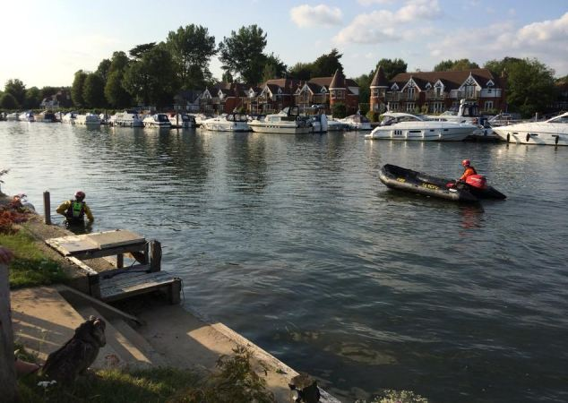 A specialist search and rescue team scours the River Thames in Marlow, Buckinghamshire yesterday