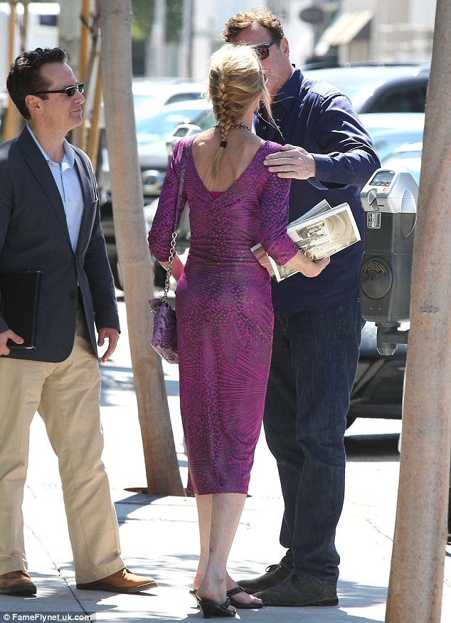Pretty in purple! The Working Girl star had dressed up, highlighting her willowy figure in a low-cut purple pencil dress featuring a funky print