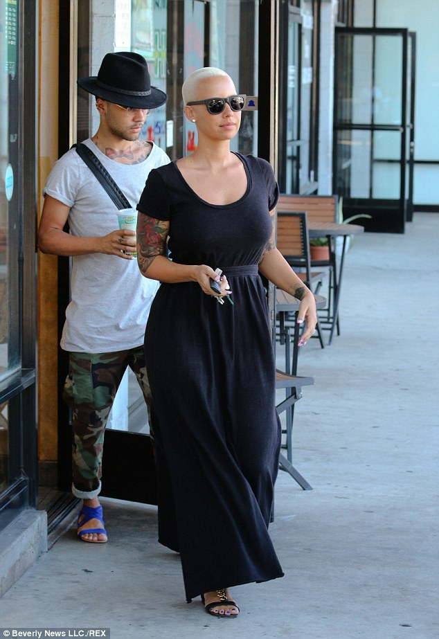 Maxi-mise her style: The model looked lovely in a black long dress