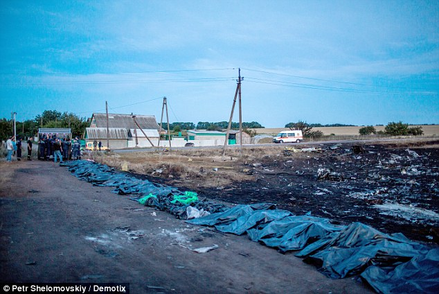 Experts will soon begin analysing the remains of the MH17 victims (pictured at crash site). Aircraft containing the bodies have begun leaving Ukraine's Kharkiv today. However contention still remains on how many bodies remain at the crash site. Officials say as many as a third of passengers may be unaccounted for