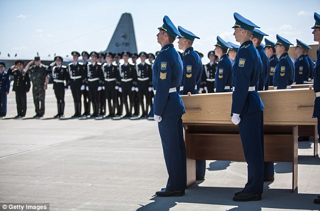 A coffin containing the body of a victim of the crash of Malaysia Airlines flight MH17 is loaded onto a plane for transport to the Netherlands during a departure ceremony today in Kharkiv, Ukraine. Malaysia Airlines flight MH17 was travelling from Amsterdam to Kuala Lumpur when it crashed killing all 298 on board
