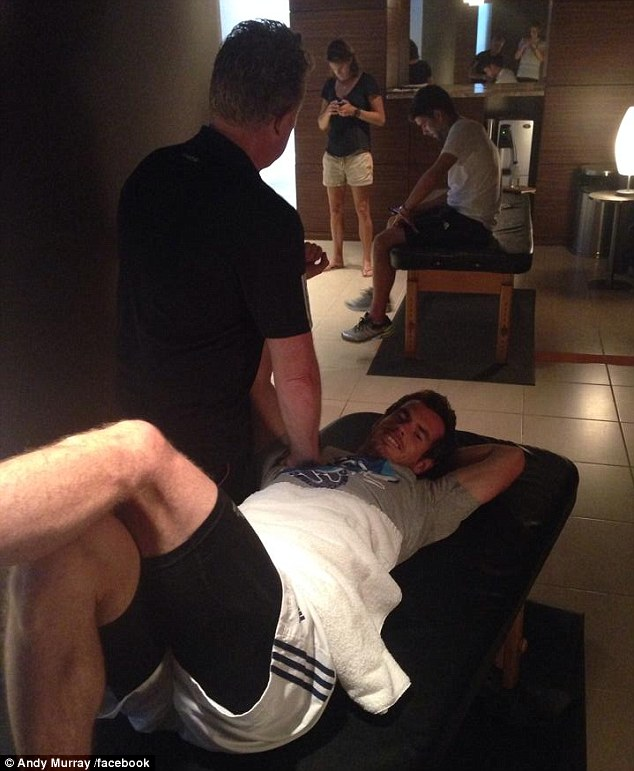 Conditioning: The British No 1 receives some treatment from his physio Mark Bender