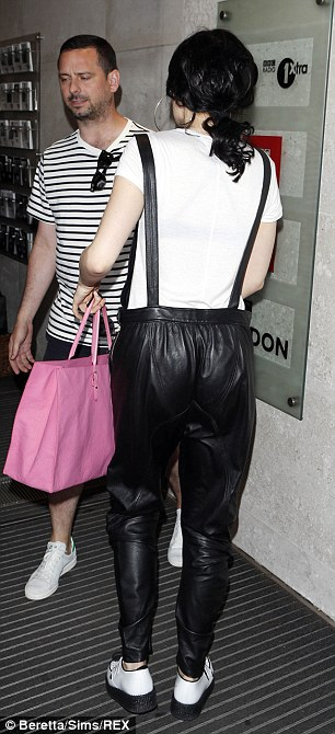 Jessie's dungarees dropped into single straps as they came over her shoulders and into the trousers