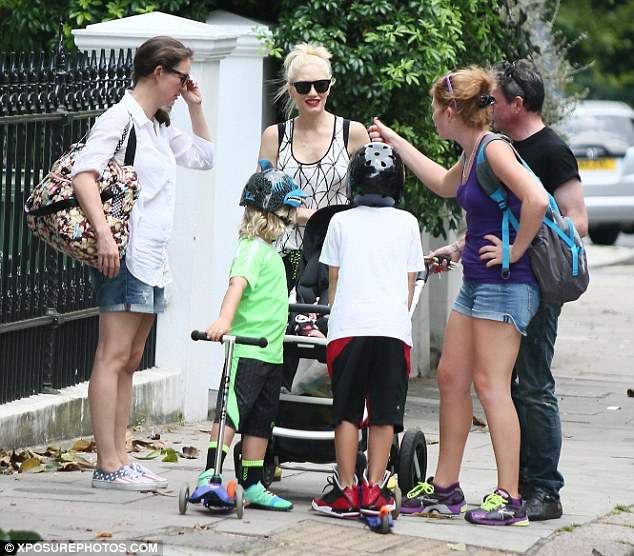 Friendly Gwen: The mum-of-three smiles as she is greeted in the street by some passers by