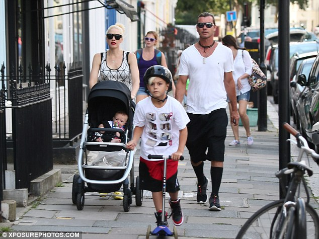 It's a family day: The lovely family took a leisurely stroll on their day out in London on Wednesday